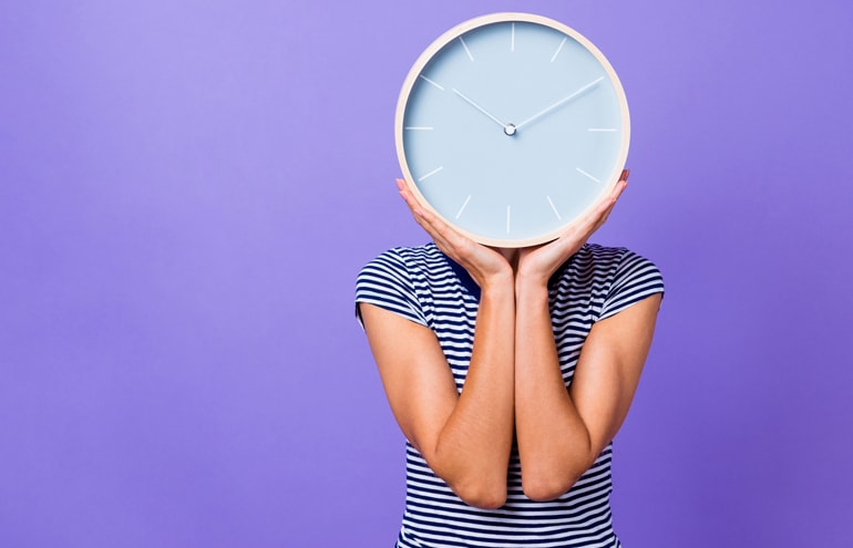 Lawyer with clock over face Billable Time
