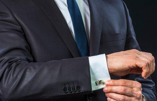 lawyer adjusting cuff lawyer fashion