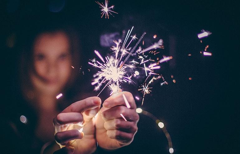 women with sparkler