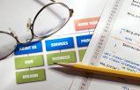 Desk with glasses and website design tools conversion focused web design